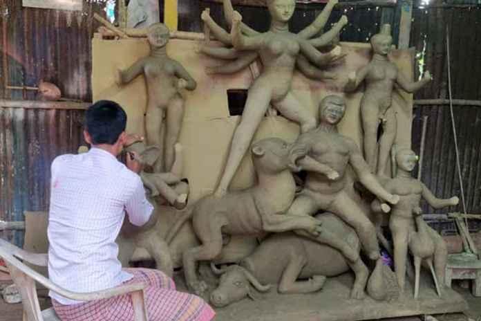 goddess durga puja idol pocso act bengal